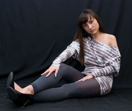 beauty girl in striped blouse on black background photo
