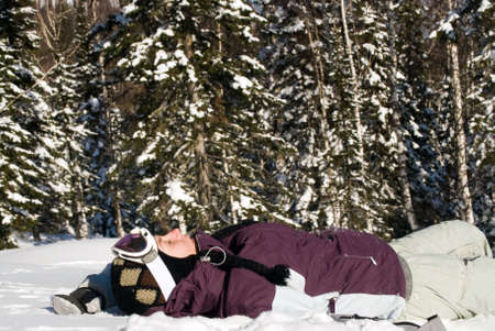 beauty tired girl on the winter forest background