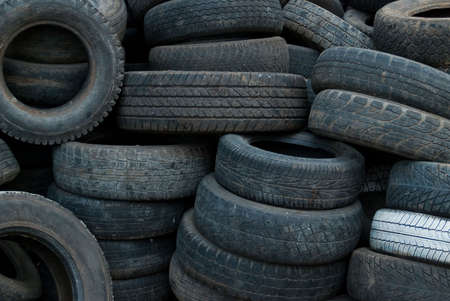 junked: a lot of different used and junked vehicle tires Stock Photo