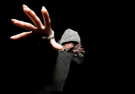 horrify: girl pulls hand and horrify on black background Stock Photo