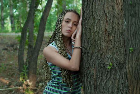 russian ethnicity caucasian: beauty girl beside poplar tree on the forest background
