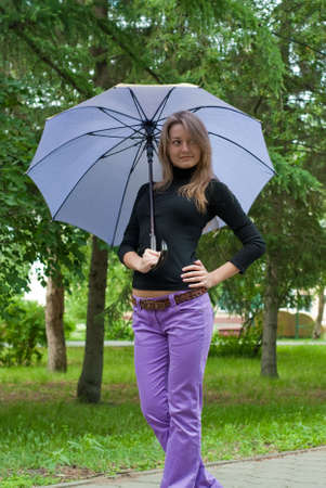 beauty girl stay with umbrella in the park on trees background Stock Photo - 5318212