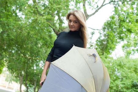 beauty girl stay with umbrella in the park on trees background Stock Photo - 5362118