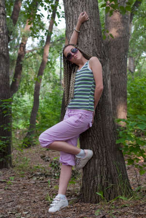 beauty girl beside poplar tree on the forest background Stock Photo - 5372032