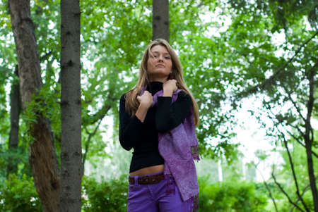 beauty girl with violet scarf in the park on trees background Stock Photo - 5481289