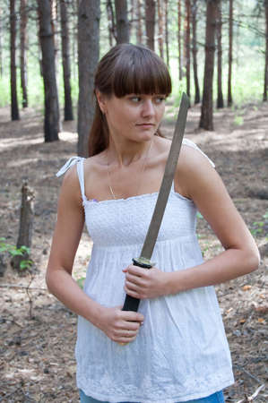 beauty girl in white dress with short sword on the trees background Stock Photo - 5533880