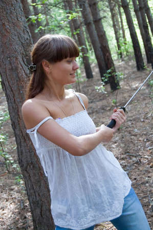 beauty girl in white dress with short sword on the trees background Stock Photo - 5544307