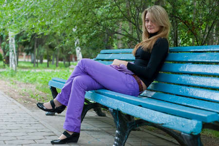 beauty girl with violet scarf on the blue bench Stock Photo - 5580649
