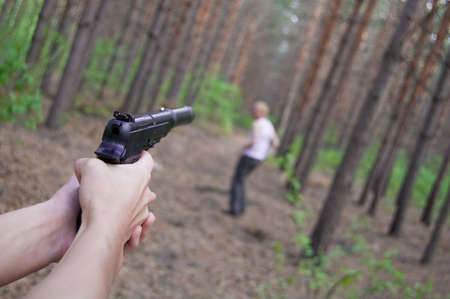 man in conifer forest run away from killer photo