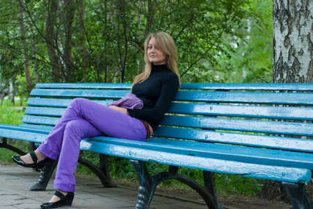 beauty girl with violet scarf on the blue bench Stock Photo - 5612856