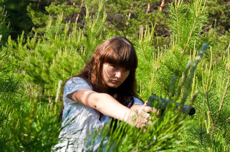 beauty girl in white dress with gun on nature background Stock Photo - 5654838
