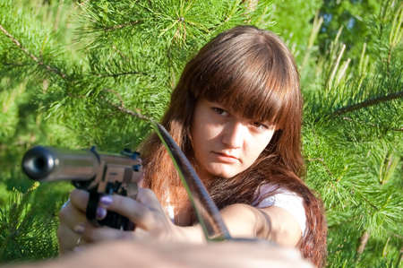 conflict beatween girl with gun and man with sword Stock Photo - 5671323