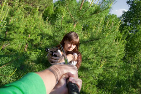 conflict beatween girl with gun and man with sword Stock Photo - 5671329
