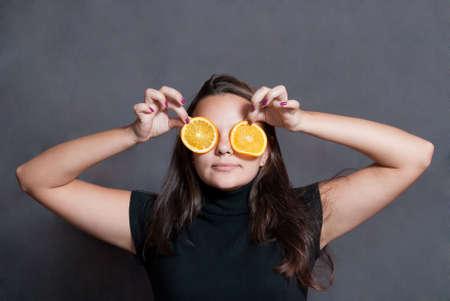 beauty girl with orange eyes on  gray background photo