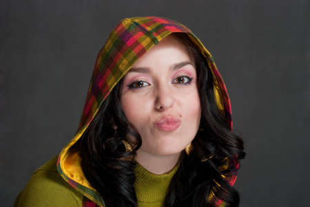 beauty girl in  hood of tattersall on the gray background photo