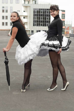 ballerina tights: two beauty girls in tutu on the building background