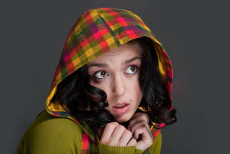 modest: beauty and modest girl in hood on the gray background Stock Photo