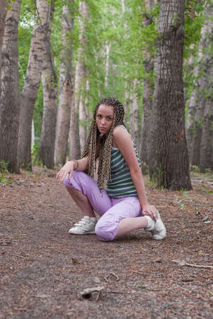 beauty girl sit at footpath on the poplar forest background photo