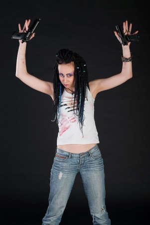 surrender: white girl raise hands with guns on black background