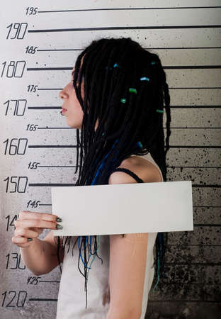 white girl in prison with injuries on ruler background. profile photo photo