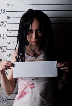 white girl in prison with injuries on ruler background photo