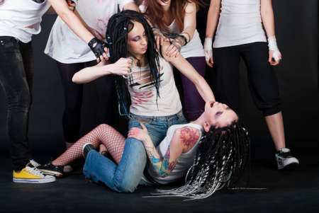 girl fighting: white fighting girls with dreads on black background. One girl with body art on her hand. Stock Photo