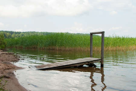 dais: lake with dais on cane and trees background Stock Photo