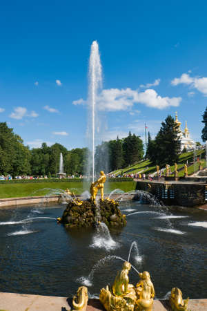 golden statue of Samson on small stone island in lower park of Peterhof. Saint Petersburg. Russia photo