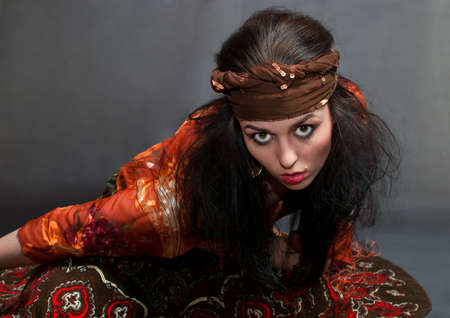 russian ethnicity caucasian: beauty young Gypsy woman on the gray background