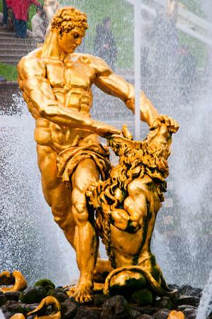 golden statue of Samson in lower park of Peterhof. Saint Petersburg. Russia Stock Photo