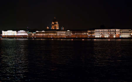 illuminated building on the waterfront of the Neva River in St. Petersburg city photo