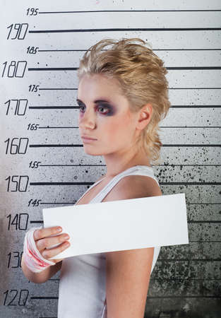 white girl profile in prison with injuries on ruler background photo