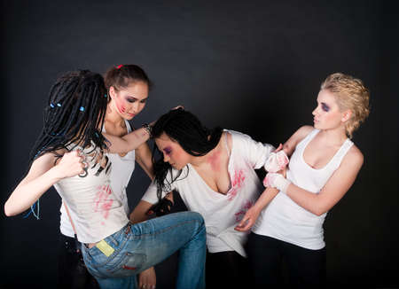 white fighting girls with dreads on black background photo