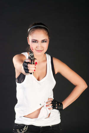 white girl shoot  handgun on black background photo