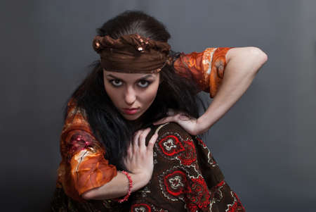 beauty young Gypsy woman on the gray background photo