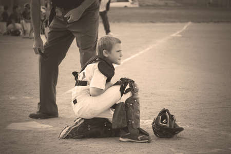 Baseball Catcher Waiting for Play to Resume photo