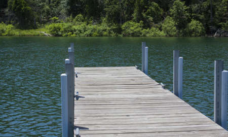 Wood and Steel Dock on a Lake Stok Fotoğraf