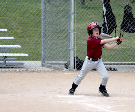 Little league baseball player batting
