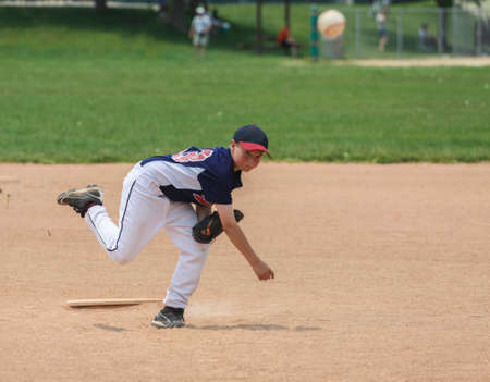 little league: Young male baseball player