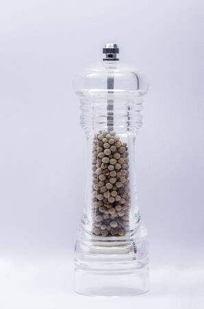 clear pepper grinder in isolate background