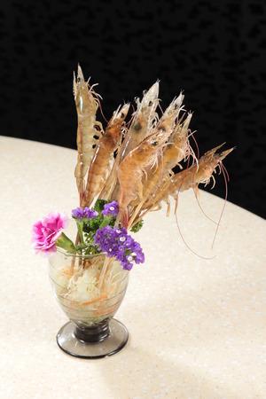 A cuisine photo of raw shrimp skewer