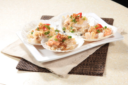 A cuisine photo of steamed scallop