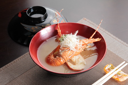 A cuisine photo of lobster miso soup