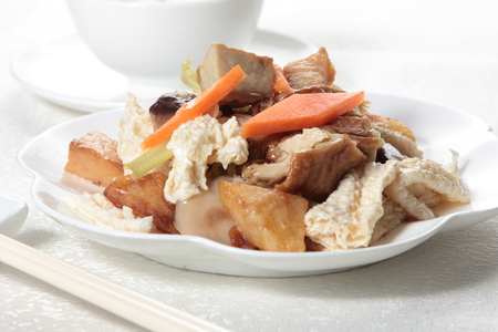 A cuisine photo of fried vegetables and mushroom