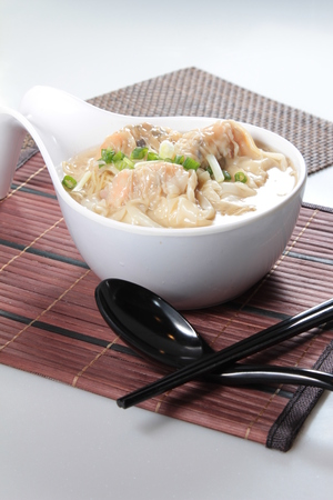 A cuisine photo of dumpling noodles