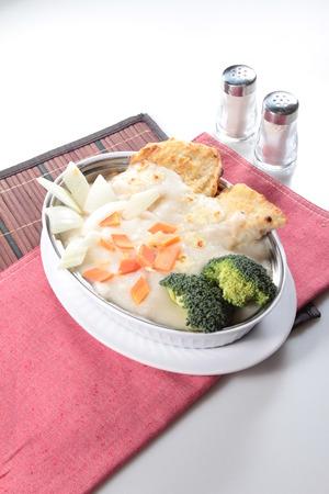 A cuisine photo of creamy pork chop risotto Stock Photo