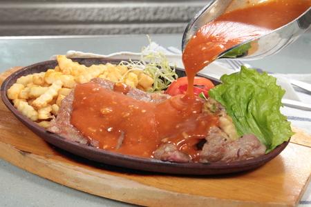 A cuisine photo of beef steak
