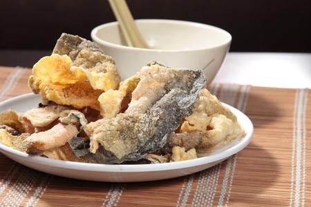 Tasty fried salmon skin in  served in a plate Zdjęcie Seryjne