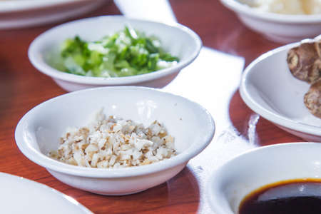a cuisine photo of spices and sauce and chili