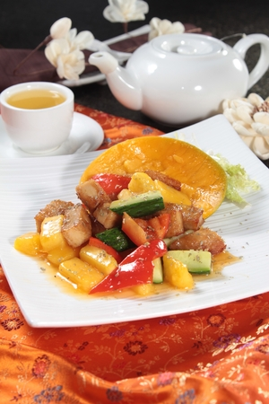 Tasty sweet and sour pork in a white plate